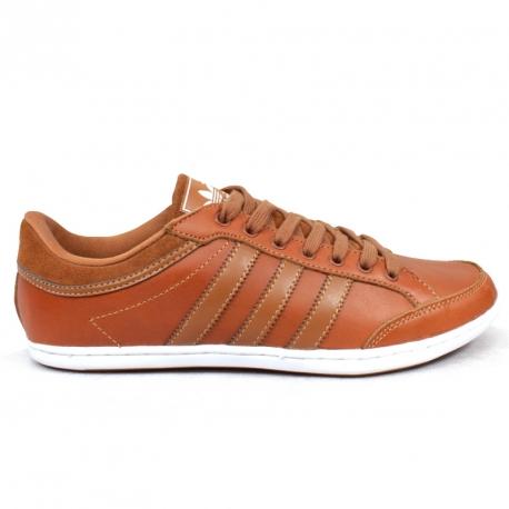Adidas Plimcana Clean Low V22667 wykonane ze skóry brązowej.